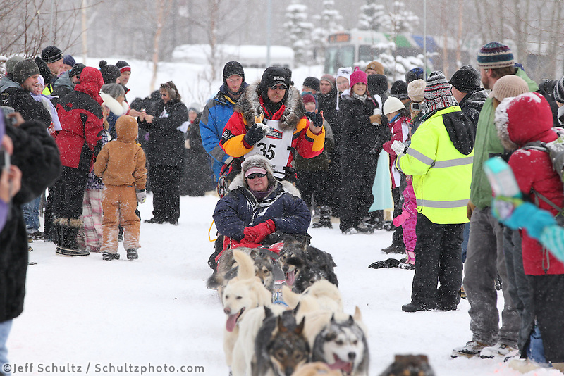 Mitch Seavey Mushes through Bike/ski trail in midtown Anchorage, During the 2012 Iditarod ceremonial start..Britt Coon/Iditarodphotos.com.