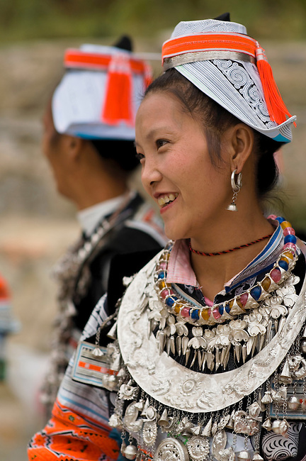Matang Gejia women wear hand made cloth head dresses and silver breastplates.