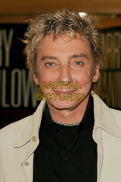 "BARRY MANILOW.Attends a signing session for his new album .""The Greatest Songs Of The Sixties"" at HMV, .London, England, December 3rd 2006..portrait headshot .CAP/DAR.©Darwin/Capital Pictures"