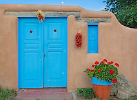 The doors to a private residence exhibit the architecture famous in Taos, New Mexico
