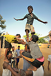 Children who work as scavengers in the municipal dump in Chennai, India, play together at a night shelter sponsored by the Madras Christian Council of Social Service.