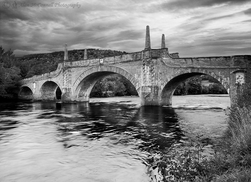 Wade's Bridge, built in 1733, crosses the River Tay at the town of Aberfeldy, Scotland.  It is one of 40 bridges that were built as part General Wade's quest to secure safe passage between the Highlands and the low country.   The Black Watch Monument stands nearby honoring the regiment of Highlanders that kept watch after the Jacobite rebellion of 1715.