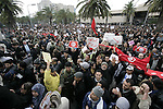 Tunisians take part in a protest in front of the headquarters of the Constitutional Democratic Rally (RCD) party of ousted president Zine al-Abidine Ben Ali during a demonstration in downtown Tunis, January 20, 2011. Tunisian police fired shots into the air on Thursday to try to disperse hundreds of protesters demanding that ministers associated with the rule of ousted president Zine al-Abidine Ben Ali leave the government. The protesters, who had gathered outside the central Tunis headquarters of the RCD, Tunisia's ruling party for several decades, refused to move back when the police fired shots from behind a metal fence. Photo by Karam Nasser