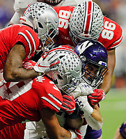 Ohio State Buckeyes defensive tackle Dre'Mont Jones (86) and Ohio State Buckeyes linebacker Malik Harrison (39) tackle Northwestern Wildcats running back Isaiah Bowser (25) during the 3rd quarter in the Big Ten Championship game in Indianapolis, Ind on December 1, 2018.  [Kyle Robertson/Dispatch]