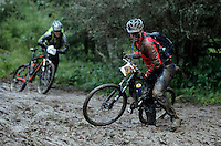 A man struggles to get out of the mud after taking a tumble. The interest for mountain bike races has exploded in Norway the last few years, particularly with middle age affluent men. The biggest is called Birkebeinerrittet, or Birken, a race of 94,6 km and 14.500 participants, and was fully booked in 41 seconds. This years race proved to be hardest ever with constant rain and low temperatures.