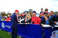 Jim Furyk (USA) signing autography after the Team pictures ahead of the 2014 Ryder Cup at Gleneagles. The 40th Ryder Cup is being played over the PGA Centenary Course at The Gleneagles Hotel, Perthshire from 26th to 28th September 2014.: Picture Fran Caffrey, www.golffile.ie: 23-Sep-14