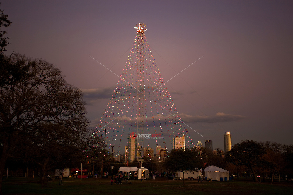 There could not have been a better way to kick off the holiday season than the 45th Annual Zilker Tree Lighting. More than 1,000 people came out to watch this year's event and as always, the winners of the Zilker Holiday Tree Drawing Contest flipped the switch to light up the 155 foot tree. This years tree has 39 lines of lights streaming down from the Zilker Park Moon Tower and over 3,300 lights illuminating the Austin Skyline.