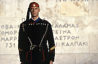 01 NOV 2003 - ATHENS, GREECE - As the sun begins to set an Evzone stands guard at the Tomb of the Unknown Soldier. (PHOTO (C) NIGEL FARROW)