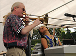 Trombone Player, Barry Olsen, and lead singer-percussionist, Valerie Naranjo, of Mandara, African Imbued Jazz Percussion Ensemble, performing at the Celebration of World Drums and Drummers Drum Boogie Festival to Benefit the Woodstock Chimes Fund, held at Cornell Park in Kingston, NY on Saturday, September 17, 2011.in , NY. Photo by Jim Peppler. Copyright Jim Peppler/2011.