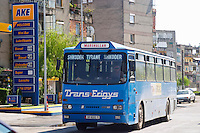 Street scene with blue bus Trans Erigys between Shkodra and Tirana. Shkodra. Albania, Balkan, Europe.
