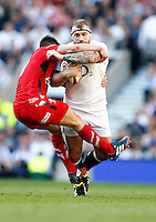 Photo: Richard Lane/Richard Lane Photography. England v Wales. RBS Six Nations. 09/03/2014. England's Joe Marler is tackled by Wales' Rhys Webb.