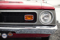 Reinholds, Pennsylvania, February 10, 2015 - A detail of the logo  and front grill of Brian Moyer's 1971 Base Model AMC Gremlin in matador red. Moyer restored the car over 20 years ago. <br /> <br /> Moyer owns 16 AMC Gremlins. The Gremlin was introduced on April Fools Day (April 1) in 1970 featuring a shortened Hornet body with a Kammback tail and was manufactured in the US via AMC and in Mexico via AMC's subsidiary VAM. It's lifecycle ended in 1978 when it was replaced by the AMC Spirit. Moyer became interested as a kid when he saw the early Gremlin commercials in 1970. His first car was a Gremlin and he has never not owned one. Today he has arguably the most unique collection of Gremlins in the world, including several that are one-of-a kind models. <br /> <br /> CREDIT: Daryl Peveto for The Wall Street Journal<br /> Photo Assignment ID: 36892 <br /> Slug: MYRIDE_Gremlin