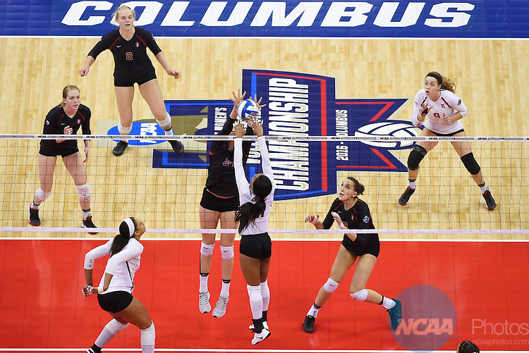 COLUMBUS, OH - DECEMBER 17:  Audriana Fitzmorris (24) of Stanford University jumps for a block against Chloe Collins (21) of the University of Texas during the Division I Women's Volleyball Championship held at Nationwide Arena on December 17, 2016 in Columbus, Ohio.  Stanford defeated Texas 3-1 to win the national title. (Photo by Jamie Schwaberow/NCAA Photos via Getty Images)