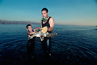 A scientist and a young boy release a Hawksbill Turtle, Eretmochelys imbricata, back into the wild after it has been tagged, Eilat Underwater Observatory Marine Park, Eilat, Israel, Red Sea, MR