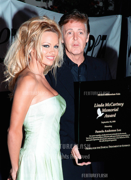 18SEP99: Pop superstar PAUL McCARTNEY presenting actress PAMELA ANDERSON LEE with the first Linda McCartney Memorial Award at PETA's Party of the Century, in Los Angeles.     .© Paul Smith / Featureflash