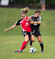 Molly Menchel (14) of the D.C. United Women collides with Emily Kittleson (6) of the Virginia Beach Piranhas during the game at the Maryland SoccerPlex in Boyds, Maryland.  The D.C. United Women defeated the Virginia Beach Piranhas, 3-0, to advance to the W-League Eastern Conference Championship.