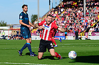 Lincoln City's Michael O'Connor vies for possession with Bristol Rovers' Edward Upson<br /> <br /> Photographer Chris Vaughan/CameraSport<br /> <br /> The EFL Sky Bet League One - Lincoln City v Bristol Rovers - Saturday 14th September 2019 - Sincil Bank - Lincoln<br /> <br /> World Copyright © 2019 CameraSport. All rights reserved. 43 Linden Ave. Countesthorpe. Leicester. England. LE8 5PG - Tel: +44 (0) 116 277 4147 - admin@camerasport.com - www.camerasport.com