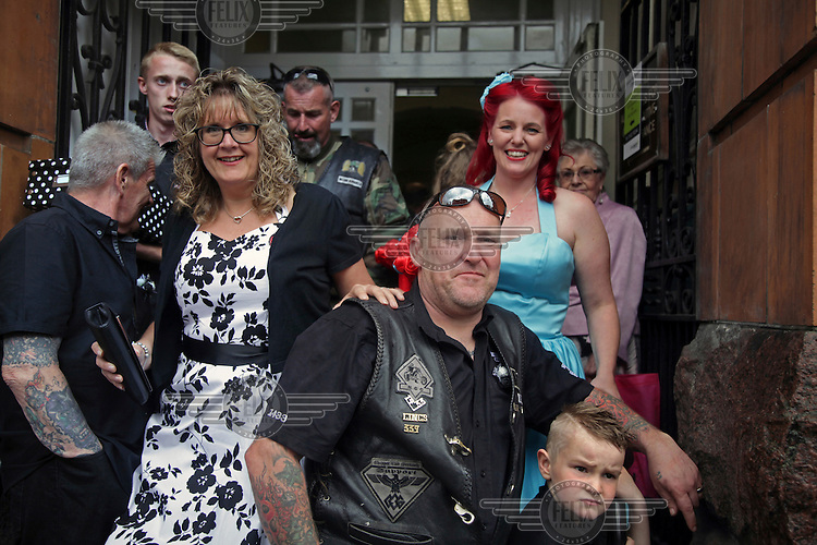 People attending the wedding of a biker/rocker couple at the town hall shelter from the rain. <br /> The town of Boston had the country's highest proportion of 'leave' votes cast in the EU referendum with almost 76 percent of ballots cast for Brexit. Lincolnshire has, in recent years, seen an influx of EU workers drawn to the area's agricultural industry. The 2011 census found about 13 percent of Boston's residents were born in Eastern Europe and migrated to the UK since 2004.