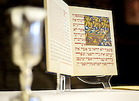 NWA Democrat-Gazette/JASON IVESTER --03/30/2015--<br /> A Haggadah, a Jewish text that sets forth the order of the Passover Seder, is set on display on Monday, March 30, 2015, inside the Lost Bridge Community Center in Garfield.
