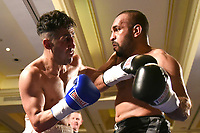 Ibrar Riyaz (black shorts) defeats Yadollah Ghasemi during a Boxing Show at the Millenium Hotel on 11th May 2017
