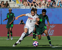 GRENOBLE, FRANCE - JUNE 22: Lena Oberdorf #6 dribbles as Halimatu Ayinde #18 closes during a game between Nigeria and Germany at Stade des Alpes on June 22, 2019 in Grenoble, France.