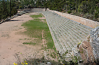 DELPHI, GREECE - APRIL 12 : A general view of the western and best preserved track of the Stadium on April 12th, 2007, in the Sanctuary of Apollo, Delphi, Greece. The Stadium was built in the 5th century BC and remodeled in the 2nd century AD when Herodus Atticus ordered the stone seating and the arched entrance. (Photo by Manuel Cohen)