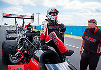 Jul 18, 2020; Clermont, Indiana, USA; NHRA top fuel driver Steve Torrence climbs into his dragster during qualifying for the Summernationals at Lucas Oil Raceway. Mandatory Credit: Mark J. Rebilas-USA TODAY Sports