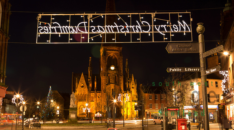 Christmas lights at dusk looking along High Street to Burns Statue and Greyfriars Church in the town centre of Dumfries Scotland