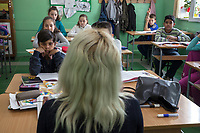Serbia. Zitkovac is a village in Central Serbia situated in the municipality of Aleksinac, in the Nišava District. « Vuk Karadzic » Elementary School. Classroom. 5th Grade. A blond teacher during a Serbian class.The school's students are from Serbian and Romani ethnicity. The boys with black hair and dark skin complexion (seated on the fist row (L) and second row (R), and the girl seated on the second row (L), all three are Roma children. The others are Serbian. The Romani (also spelled Romany) or Roma, Roms or Gypsies, are a traditionally itinerant ethnic group. The Pestalozzi Children's Foundation (Stiftung Kinderdorf Pestalozzi) is advocating access to high quality education for underprivileged children. It supports in Zitkovac a project called » Together in transition ».19.4.2018 © 2018 Didier Ruef for the Pestalozzi Children's Foundation