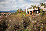 Visoko. The hills surrounding Visoko are squatted with ruins of houses and landmines along the former front lines. Owners are not able to return before the area is cleared.
