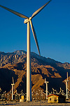 Array of windmills at wind farm at sunrise, below the San Jacinto Mountains, Palm Springs, California