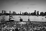"""Mumbai, the city symbolic of the Indian miracle and its sustained economic growth, will become, in 2020, the most populopus metropolis of the world. Today more than 40% of its inhabitants lives in the various slums and shantytowns that define the urban landscape of this Indian """"megacity""""Among the slums, the best known is Dharavi, thanks also to the international success of the Slumdog Millionaire movie. .One of the slum in Colaba in front of the economic center of mumbai, May 10, 2007."""