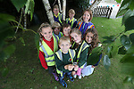 Welsh Water teacher Mari Wort  with pupils from various schools Tom Insole, Joshua Battle, Seren Russell, Steffan Evans, Sam Stopgate, Emily Davies, Sara Jones &amp; Rohan Efstathiou taking part in Bio Diversity Week at Welsh Water Education Centre Cog Moors.<br /> <br /> 24.06.13<br /> &copy;Steve Pope-FOTWALES
