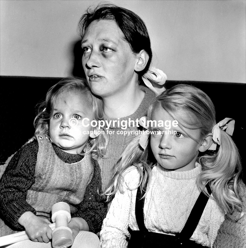 Anita Currie, wife of SDLP MP Austin Currie, with her 2 children, following an attack in her Dungannon home by two armed men. 197211160724.<br /> <br /> Copyright Image from Victor Patterson, 54 Dorchester Park, <br /> Belfast, UK, BT9 6RJ<br /> <br /> t1: +44 28 9066 1296 (from Rep of Ireland 048 9066 1296)<br /> t2: +44 28 9002 2446 (from Rep of Ireland 048 9002 2446)<br /> m: +44 7802 353836<br /> <br /> e1: victorpatterson@me.com<br /> e2: victorpatterson@gmail.com<br /> <br /> www.victorpatterson.com<br /> <br /> Please see my Terms and Conditions of Use at www.victorpatterson.com. It is IMPORTANT that you familiarise yourself with them.<br /> <br /> Images used on the Internet must be visibly watermarked i.e. &copy; Victor Patterson within the body of the image and copyright metadata must not be deleted. Images used on the Internet have a size restriction of 4kbs and will be chargeable at current NUJ rates unless agreed otherwise.<br /> <br /> This image is only available for the use of the download recipient i.e. television station, newspaper, magazine, book publisher, etc, and must not be passed on to any third party. It is also downloaded on condition that each and every usage is notified within 7 days to victorpatterson@me.com<br /> <br /> The right of Victor Patterson to be identified as the author is asserted in accordance with The Copyright Designs And Patents Act (1988).