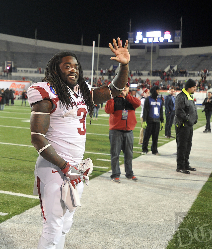 NWA Democrat-Gazette/MICHAEL WOODS • @NWAMICHAELW<br /> University of Arkansas running back Arkansas running back Alex Collins (3) waves to the fans following the Razorbacks 45-23 win over Kansas State in the 57th annual AutoZone Liberty Bowl January 2, 2016.