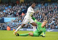 Picture by Howard Roe/AHPIX.com. Football, Barclays Premier League; <br /> Manchester City v Swansea City ;22/11/2014 KO 3.00 pm <br /> Etihad Stadium;<br /> copyright picture;Howard Roe;07973 739229<br /> Swansea's Wilfred Bony beats   Manchester's Joe Hart to score the opening goal