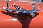 Westbury, New York, USA. June 12, 2016. Chrome Flying Bird Rocket Eagle hood ornament is seen in close up on red 1955 Chevrolet Belair, owned by Robert McDonough of New Hyde Park,  at the Antique and Collectible Auto Show at the 50th Annual Spring Meet at Old Westbury Gardens, in the Gold Coast of Long Island, and sponsored by Greater New York Region, GNYR, Antique Automobile Club of America, AACA.