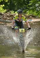 NWA Democrat-Gazette/BEN GOFF @NWABENGOFF<br /> Erik Leamon, a category 1 racer from Conway, fords a creek Sunday, July 16, 2017, during cross country races on the final day of the 19th annual Fat Tire Festival at Lake Leatherwood City Park in Eureka Springs.