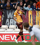 Motherwell's Marvin Johnston sucks his thumb after scoring the opener