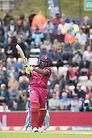 Chris Gayle (West Indies) plus Chris Wakes (England) over wide mid on for four during England vs West Indies, ICC World Cup Cricket at the Hampshire Bowl on 14th June 2019