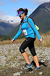 NELSON LAKES, NEW ZEALAND - APRIL 18:  Raechel Whalley crosses the Travers River during the 2015 Alpine Lodge Loop The Lake trail run at Lake Rotoiti on April 18 16, 2015 in Nelson, New Zealand. (Photo by Marc Palmano/Shuttersport Limited)