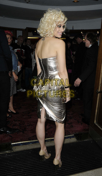 Kimberly Wyatt.'The Hurly Burly Show' VIP gala night, Duchess Theatre, Catherine St., London, England..July 10th, 2012.full length silver gold metallic dress peplum strapless back behind rear looking over shoulder tattoo fringed .CAP/CAN.©Can Nguyen/Capital Pictures.