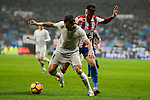 Real Madrid's player Pepe and Sporting de Gijon's player Carmona during match of La Liga between Real Madrid and Sporting de Gijon at Santiago Bernabeu Stadium in Madrid, Spain. November 26, 2016. (ALTERPHOTOS/BorjaB.Hojas)