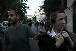 Israeli policemen arrest an Ultra-Orthodox Jew during the Sabbath riots that were continued this week, in protest against the opening of a parking lot on the Shabbat day of rest, Jerusalem, Saturday, June 27, 2009. Approximately 40 ultra-Orthodox demonstrators were arrested and six people were wounded during the riots. Photo By : Omer Hecht / JINI
