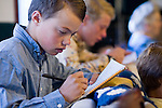"""Sept 8, 2008 -- COLORADO CITY, AZ: Boys in the Jessop family finish their homework during morning prayers before home schooling starts. Members of the FLDS pulled their children from the public schools several years ago, now most of the families in town home school their children. The Jessops have almost 40 youngsters, in grades kindergarten through 8th grade, in their home school. Colorado City and the neighboring town of Hildale, UT, are home to the Fundamentalist Church of Jesus Christ of Latter Day Saints (FLDS) which split from the mainstream Church of Jesus Christ of Latter Day Saints (Mormons) after the Mormons banned what they call """"Celestial Marriage"""" (polygamy) in 1890 so that Utah could gain statehood into the United States. The FLDS Prophet (leader), Warren Jeffs, has been convicted in Utah of """"rape as an accomplice"""" for arranging the marriage of teenage girl to her cousin and is currently on trial for similar, those less serious, charges in Arizona. After Texas child protection authorities raided the Yearning for Zion Ranch, (the FLDS compound in Eldorado, TX) many members of the FLDS community in Colorado City/Hildale fear either Arizona or Utah authorities could raid their homes in the same way. Older members of the community still remember the Short Creek Raid of 1953 when Arizona authorities using National Guard troops, raided the community, arresting the men and placing women and children in """"protective"""" custody. After two years in foster care, the women and children returned to their homes. After the raid, the FLDS Church eliminated any connection to the """"Short Creek raid"""" by renaming their town Colorado City in Arizona and Hildale in Utah. The Jessops are a polygamous family and members of the FLDS.   Photo by Jack Kurtz / ZUMA Press"""