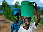 Women carrying water on their heads while walking in Dofu, an area in northern Malawi which has been hit hard by drought and hunger.