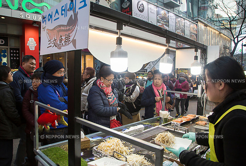 Myeongdong Shopping Street, Mar 7, 2017 : Local street food on Myeongdong shopping street which is famous shopping mecca for tourists from China, Japan and other countries in Seoul, South Korea. China ordered last week their travel agencies to stop selling group tours to South Korea after South Korean defence ministry completed a deal with Lotte Group to deploy a Terminal High Altitude Area Defense (THAAD) battery of the U.S. Army on a Lotte golf course in Seongju, about 260 km southeast of Seoul. The U.S. and South Korea had agreed to station the anti-missile battery with a high-powered radar to counter missile threats from North Korea but China opposed the deployment as they asserted the United States will spy on Chinese military with THAAD. South Korean duty-free shops, hotels and travel agencies will be hit by the travel restrictions of China, local media reported. (Photo by Lee Jae-Won/AFLO) (SOUTH KOREA)