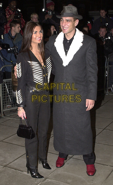"VINNIE JONES & WIFE TANYA .Arrivals at film premiere of ""Mean Machine"", London, .18th December 2001..full length hat white fur trimmed collar coat.Ref: HT.www.capitalpictures.com.sales@capitalpictures.com.©Capital Pictures."