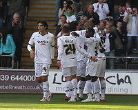 ATTENTION SPORTS PICTURE DESK<br /> Pictured: Jason Scotland of Swansea mobbed by team mates celebrating his opening goal<br /> Re: Coca Cola Championship, Swansea City FC v Norwich City FC at the Liberty Stadium Swansea, south Wales. Saturday 11 April 2009.<br /> Picture by D Legakis Photography / Athena Picture Agency, Swansea 07815441513
