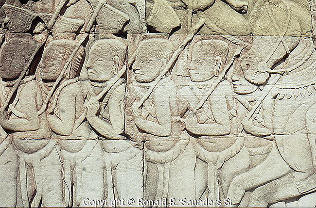 The outer wall of the outer gallery features a series of bas-reliefs depicting historical events and scenes from the everyday life of the Angkorian Khmer. Though highly detailed and informative in themselves, the bas-reliefs are not accompanied by any sort of epigraphic text, and for that reason considerable uncertainty remains as to which historical events are portrayed and how, if at all, the different reliefs are related